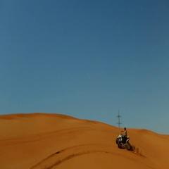 Arab man drifting quad bike on desert. Stock Footage