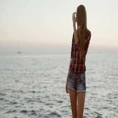 Beautiful young woman posing at a sea background Stock Footage