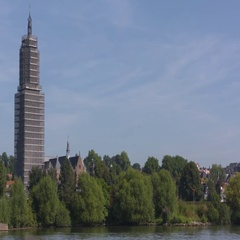 Late gothic Cunera tower in scaffolding, at the north bank of the river Rhine Stock Footage