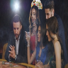 A group of young and beautiful people drinking champagne and playing blackjack Stock Footage
