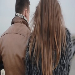 Backview of a dark-haired couple, having a walk on a roof, kissing, talking Stock Footage