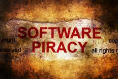 Software piracy grunge concept Stock Photos