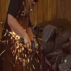 Woman blacksmith forges a horseshoe Stock Footage