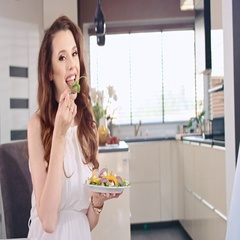 Happy pregnant lady eating salad - slow motion Stock Footage