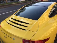 Berlin, Germany - November 12, 2016: behind view of yellow Porsche car Stock Photos
