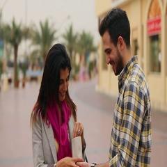 Couple eating roasted nuts, Dubai, United Arab Emirates. Stock Footage