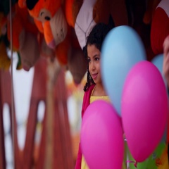 Girl playing with balloons at funfair, Dubai, United Arab Emirates. Stock Footage