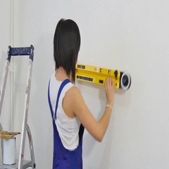 Brunette young woman using spirit level Stock Footage