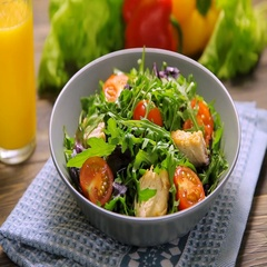 Fresh salad with chicken, tomatoes, arugula, mesclun, basil and tomato juice Stock Footage