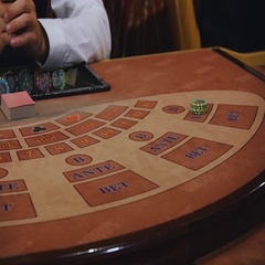 Dealer moves the cards to player. The game of blackjack with an elegant woman Stock Footage