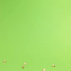 Falling grains pearl barley on heap of pearl barley on a green screen Stock Footage