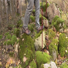 Hiker with hiking poles in rocky area Stock Footage