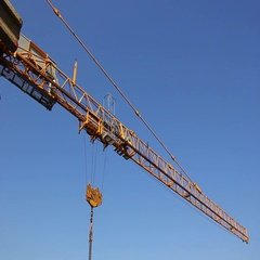 Tower crane, construction sites, high-rise buildings and green areas Stock Footage