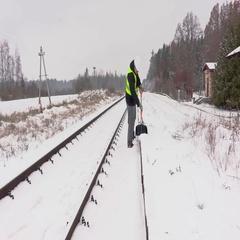 Railroad worker clean snow from platform near railway Stock Footage