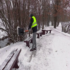 Janitor with snow shovel  cleaning Stock Footage
