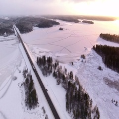 Semitrailers and small vehicles driving on winter route Kola. Panorama. Karelia Stock Footage