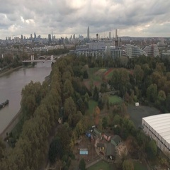 Aerial push out view from Chelsea bridge on the river Thames Stock Footage