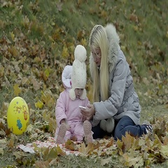 Abstract Mom with a Small Daughter Looking Photo on the Phone in the Park Stock Footage