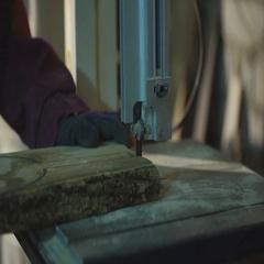 Pine Wood Trimming with Band saw at Sawmill Stock Footage