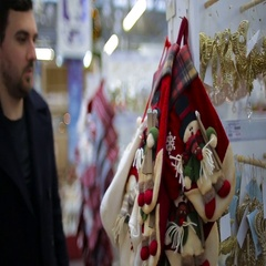 Man chooses Christmas toys in a supermarket Stock Footage