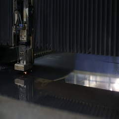 Industrial robotic laser cutter cuts metal parts Stock Footage
