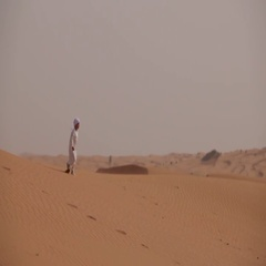 Young arab boy running in the desert. Stock Footage