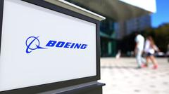 Street signage board with Boeing Company logo. Blurred office center and walking Piirros