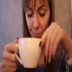 Girl is drinking delicious coffee Stock Footage