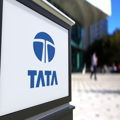 Street signage board with Tata Group logo. Blurred office center and walking Stock Footage