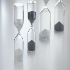 Sand flows through a hourglass Arkistovideo
