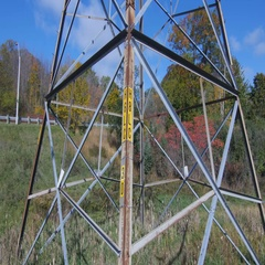 Base of hydro-electric tower with fall leaves. Stock Footage
