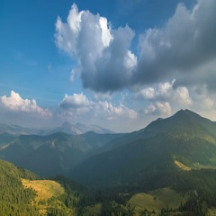 The picturesque cloud stream against the background of a mountain. Wide angle Stock Footage