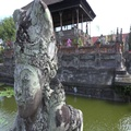 4k Bali temple sculpture close up panning with temple pond and water fountains 4k or 4k+ Resolution