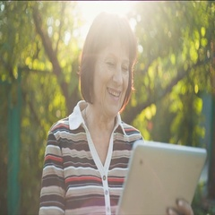 Aged Woman Talking by Skype Stock Footage