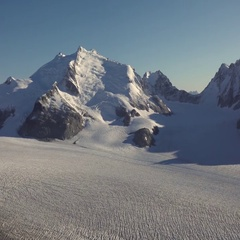 Solid Ice Encased Massive Icecap and Flowing Mountain Glaciers Stock Footage