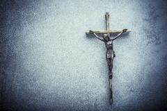 Crucifix of Jesus on the cross with stone background Kuvituskuvat