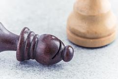 Fallen bishop, black chess piece in close up Stock Photos