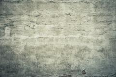 Empty stone wall with damage and cracks Stock Photos