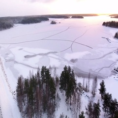 Delta of frozen Segezha river in sunset light and winter Kola route are in north Stock Footage