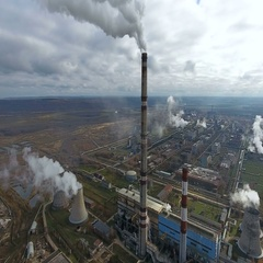 Ecology pollution. Industrial factory pollutes the environment blowing smoke Stock Footage