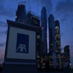 Street signage board with AXA logo in the evening. Blurred business district Stock Footage