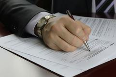 Hand signed tax form Stock Photos