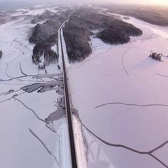 Panorama of the frozen river Segezha and highway Kola in the winter season, Rus Stock Footage