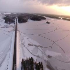Aerial view at the Kola northern highway in Karelia with bridge across river, Ru Stock Footage