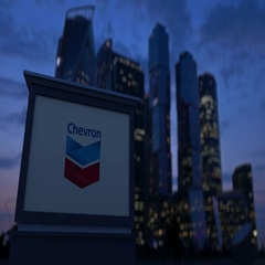 Street signage board with Chevron Corporation logo in the evening. Blurred Stock Footage