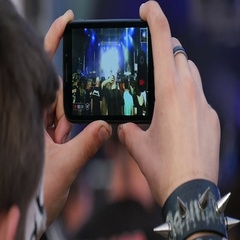 Young rock fan recording video of concert on his smartphone, slow motion 1 Stock Footage