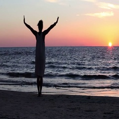 Silhouette of a woman who performs yoga exercises at sunset by the sea. Stock Footage