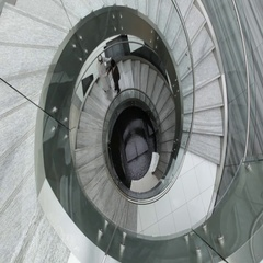 Businessmen walking up the spiral staircase. Stock Footage