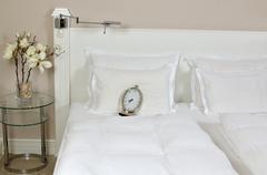 Alarm Clock on a Bed Kuvituskuvat