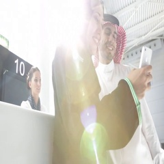 Arab couple standing at airport check-in counter. Stock Footage